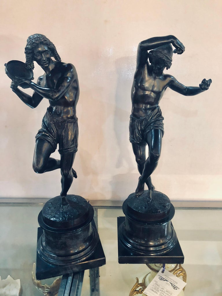Pair ofpatinated bronze figures of male dancers signed Duret, Neapolitan fisher dancing the Tarantella, 1833 and Delafontaine. Each mounted on a truncated marble pedestal. Height overall 21 1/2 inches, height of figures 17 inches. Figure with
