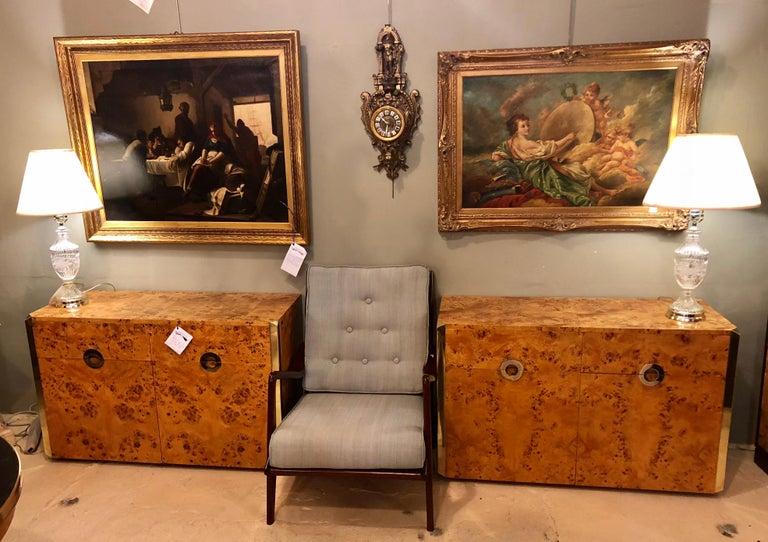 A fine custom pair of Willy Rizzo commodes or nightstands with brass accents in a light burl wood. These one of a kind chests have been fully finished and polished, brass and wood. Each having a burled wood with brass trim and inset brass pulls on