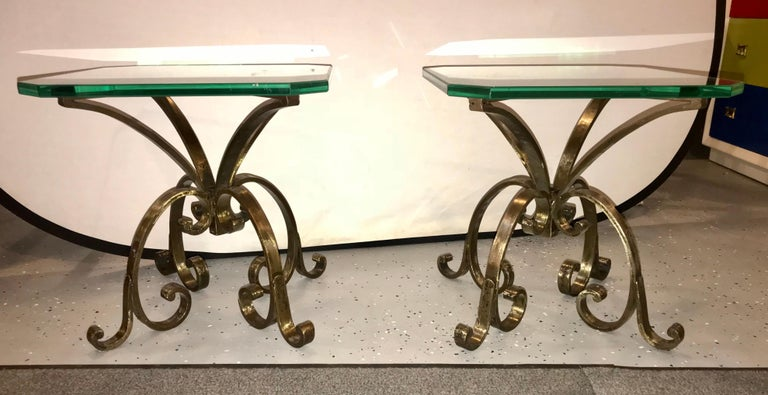 A pair of welded steel end or pedestal tables having 3/4 inches tops glass. Each handcrafted end or pedestal table is crafted in a hand hammered manner with swirls and scroll designs. Placing these 18 inch tables together would make a beautiful