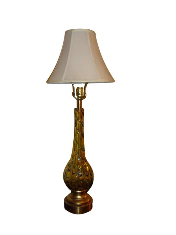Pair of multicolored Murano glass table lamps. Each bulbous form base lamp leading to a long neck stem supporting a lampshade. Both on brass based. Having green, yellow, blue and a tinge of orange these lamps are not only stylish and decorative but