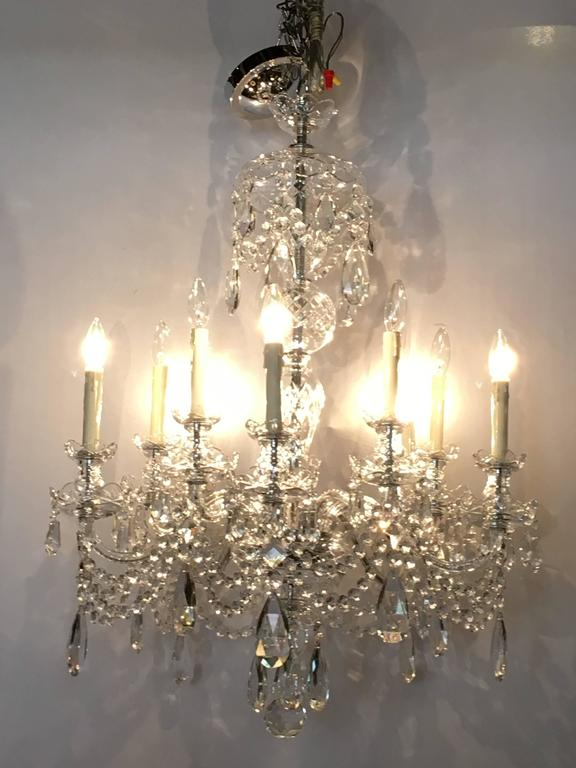 A ten-light cut crystal Georgian style chandelier. This recently re-wired and cleaned chandelier depicts the Georgian Era in its full light and grandeur. Having an enormous amount of the finest cut crystals this ten light chandelier is certain to