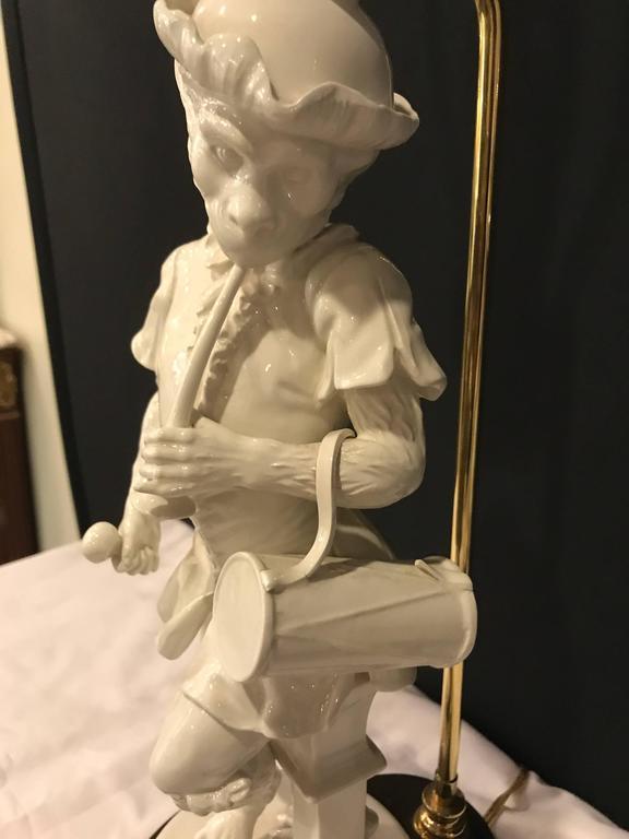 Pair of White Porcelain Opposing Monkey Lamps For Sale 4