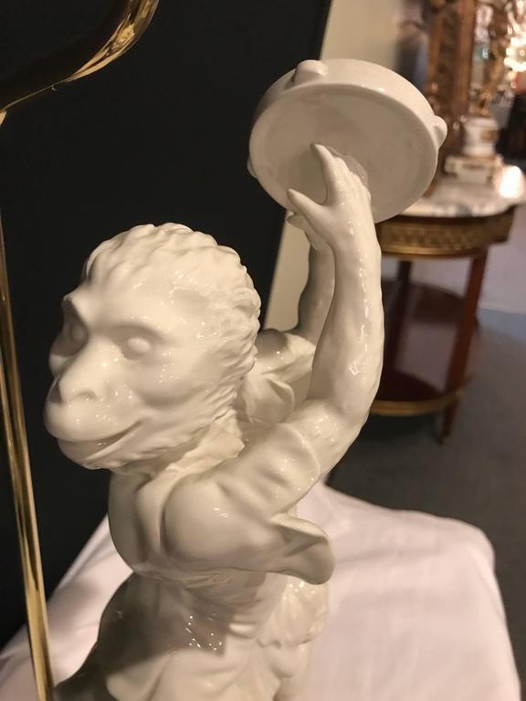 Pair of White Porcelain Opposing Monkey Lamps For Sale 5