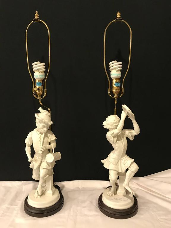 20th Century Pair of White Porcelain Opposing Monkey Lamps For Sale