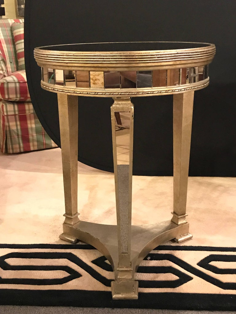 Pair of Hollywood Regency style mirrored and silvered end lamp tables. Recent reproductions having all mirrored inserts.