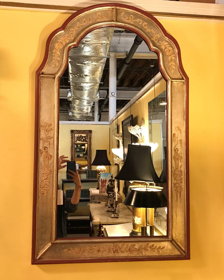 Fine silver gilt with oriental decoration La Barge chinoiserie mirror having a design depicting woman, houses and trees.