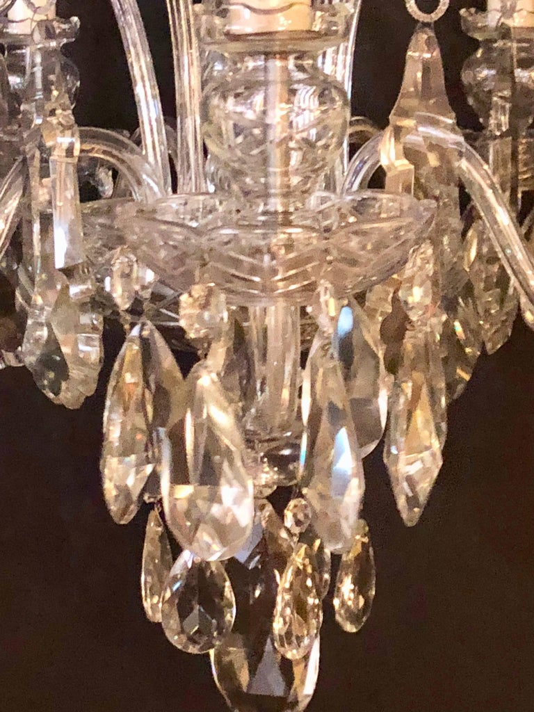 Fine cut crystal Georgian chandelier with large pendants. Recently repaired. The centre cut-glass column having five lighted arms with S-scroll cut-glass designs between them. The crystals of fine quality. Recently rewired. Possibly by Schonbek.