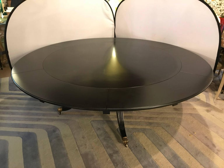 Monumental Hollywood Regency Custom-Made Ebony Circular Extending Dining Table In Good Condition For Sale In Stamford, CT