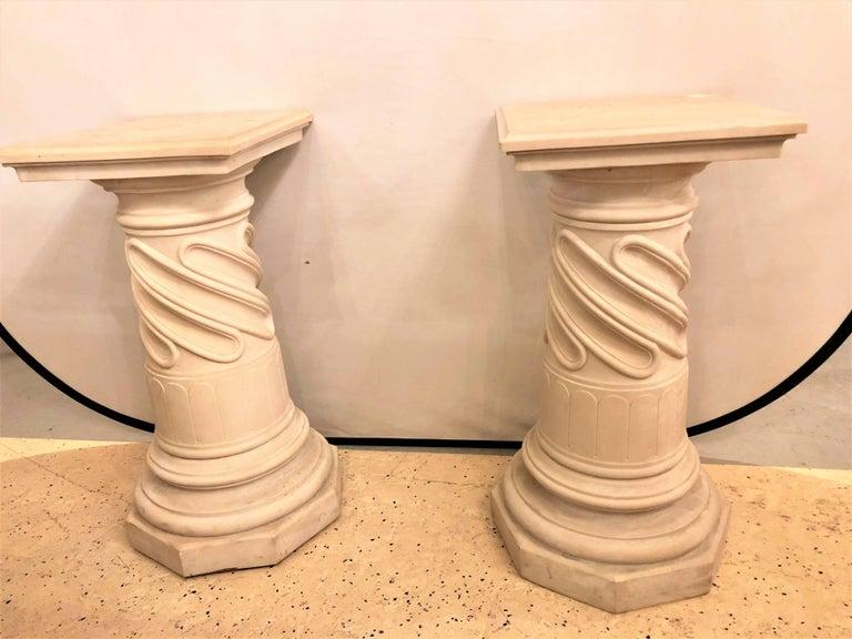 A pair of composite column form pedestals.