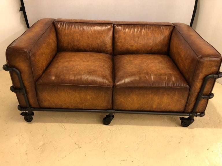 Pair of Industrial Style Sofas on Metal Frame Piping with Casters