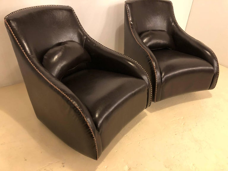 Pair of fine leather rocking chairs in the Mid-Century Modern style each hand-stitched.