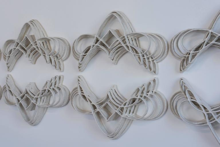 Contemporary American ceramic artist Joanna Poag's Flourish II sculptures are hand built and glazed white to give them a lightness and more attention to shadow. Flourish II looks at the growth and development of a system both healthy and beautiful.
