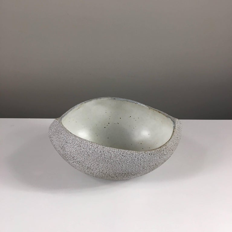 Contemporary ceramic artist Yumiko Kuga's glazed stoneware boat shaped bowl no. 069b is part of her Crackle series. All of the pieces in this series are hand-built and 100% handmade so they are one-of-a-kind and thus vary slightly from one another.