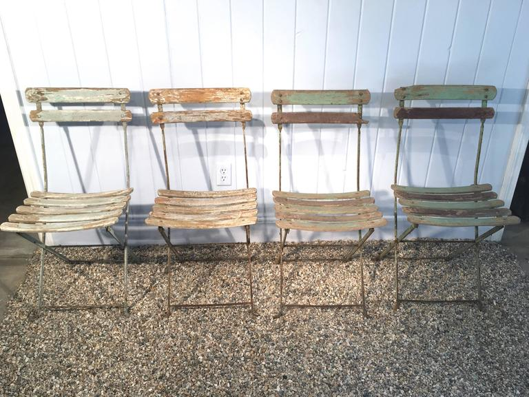 Set Of Four French Painted Wood And Iron Folding Bistro