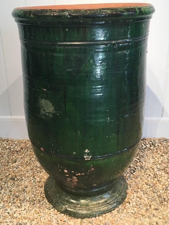 This beauty comes from Apt in the Provence region of France and has the most stunning dark emerald green colored glaze. In marvelous condition, it has a small chip to the foot (shown in photo #9) and a small repair to the foot. Because it is glazed