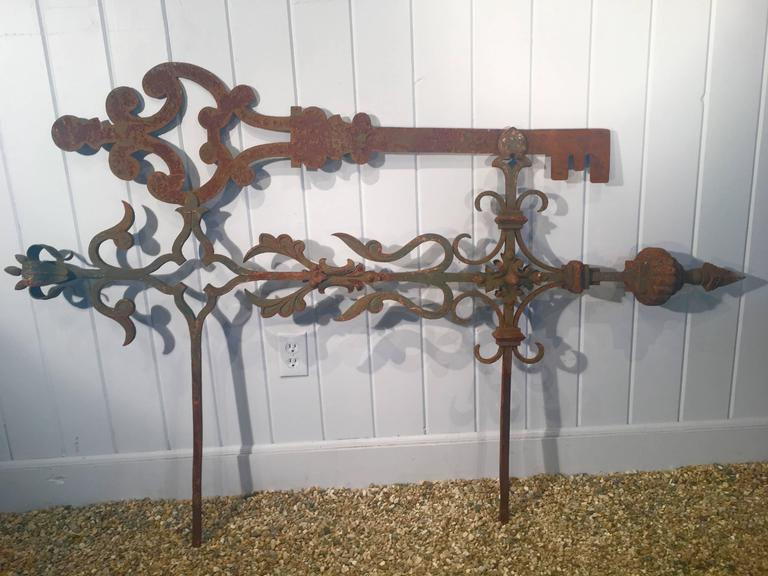 Now here is a piece you don't find every day! This late 18th-early 19th century wrought iron trade sign once hung outside a key maker's shop, embedded into the stone walls with the two long horizontal arms. It has an outstanding patina with remnants