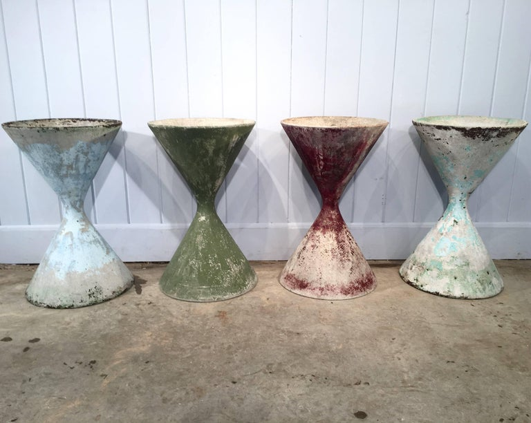 Designed by the iconic Willy Guhl in the early 1960s, and made of fiber cement by Eternit, SA, these planters sport various shades of old, weathered paint and are in excellent condition (except for one small and barely-visible chip to the rim of the