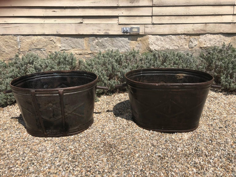 This pair of steel wine-harvest buckets has been burnished to a stunning patina and would make wonderful planters or accessories in your wine cellar. From Burgundy, they both have a wonderful raised diamond-shaped design on the exterior and are
