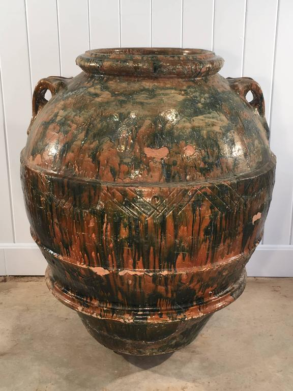 Beautifully-glazed in naturalistic green and brown and stamped with the