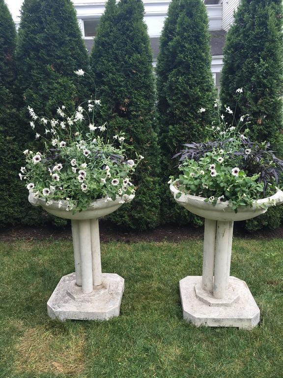 This cast stone font has it all! Worn pale cream-colored paint, mossy edges, good depth, stunning form, and great presence. Its superb height makes it a prime candidate for a focal point in your garden or on the terrace. With great versatility, it