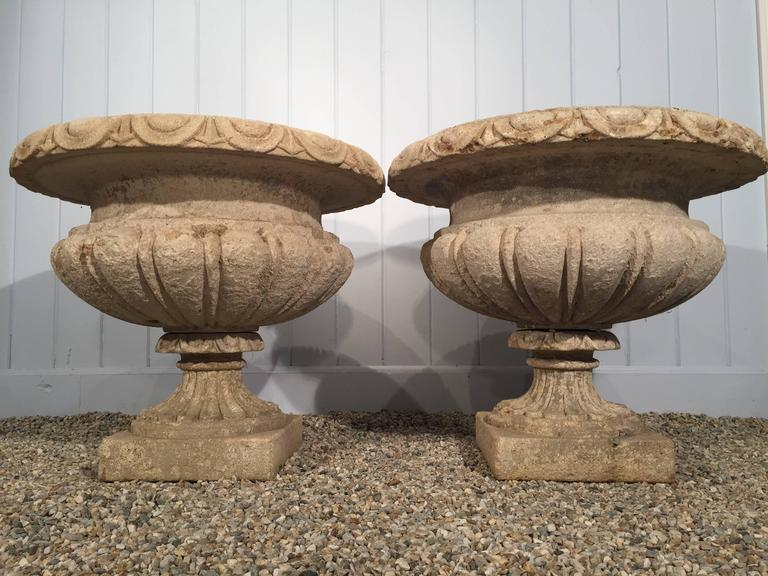 Hand-Carved Set of Four Large Carved Limestone Urns from Michael and Diandra Douglas Estate For Sale