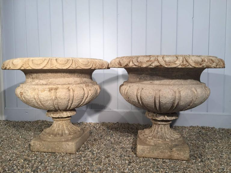 Neoclassical Revival Set of Four Large Carved Limestone Urns from Michael and Diandra Douglas Estate For Sale