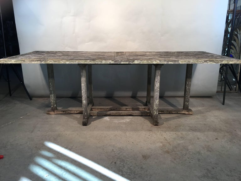 This large rectangular teak table will seat 8-10, and it features a lovely weathered surface that is clean enough to dine on but does not disappoint patina-wise. It is very solid with tight joints and has no wobble to it. Place it in your garden or