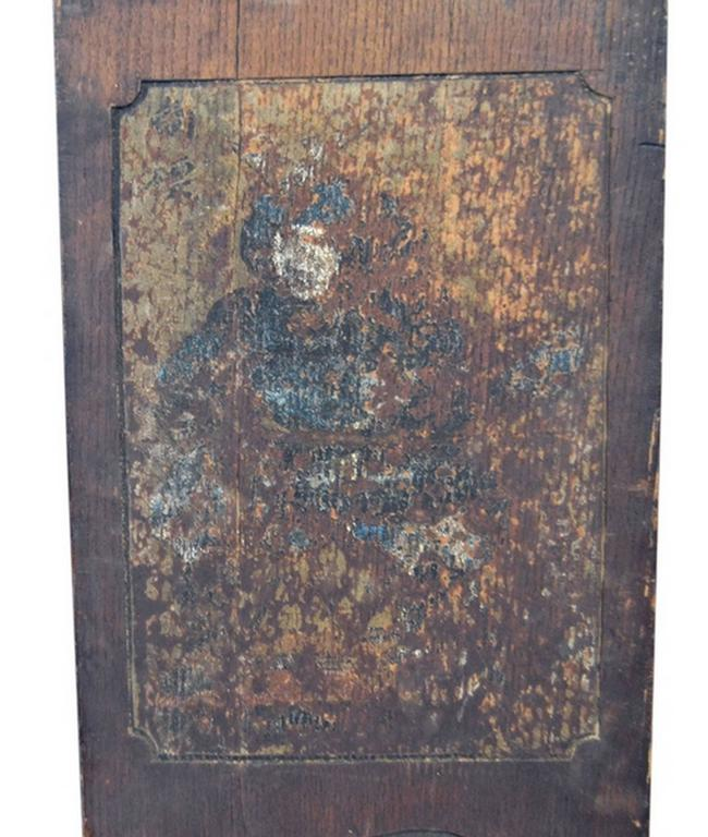 This 19th century wooden sign with calligraphy was made in Japan during the Meiji period. This narrow wooden panel is lightly carved to create a frame and four calligraphic symbols. The upper section showcases remnants of a painted scene, probably a