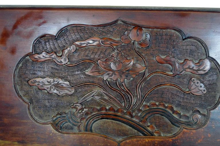 Antique Chinese hand-carved lacquered wooden wall plaque.