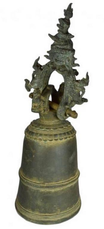 An elaborately decorated 18th century bronze bell from Burma. This bell features a tall belly with three decorative rings, the top ring featuring petal motifs. The bell can be hung thanks to a ring displaying a rich foliage and lion adornment and