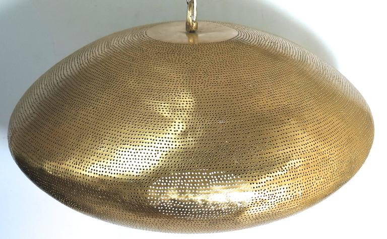 Brass fixture with pierced holes. A modern shape that creates an interesting light. Available in custom sizes. Pictured 21