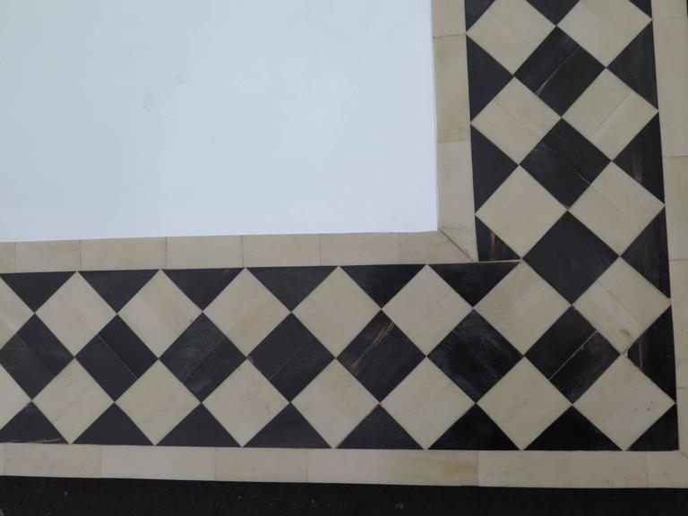 Very nice bone and ebonized wood mirror with checker design.