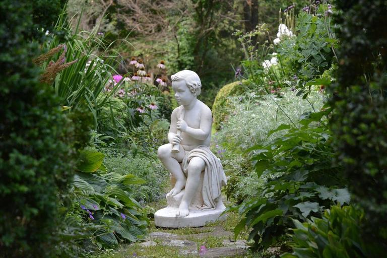 Romantic Carved Marble Statue of a Youth For Sale