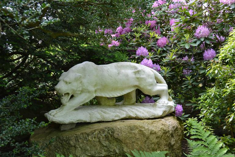 An exceptional Art Moderne carved marble figure of a tiger, captured mid-stride and on the hunt with articulated musculature. Shown on an elevated outcropping this realistic yet stylized predator is a powerful addition to a contemporary property.