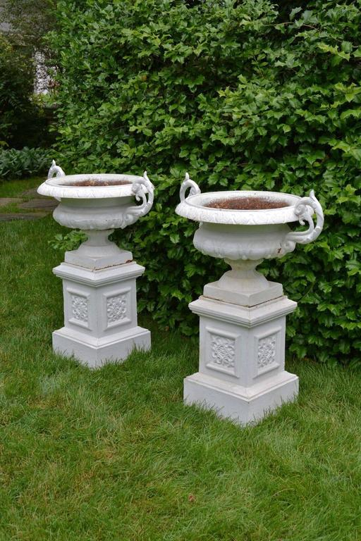 Victorian A Pair of White Painted Cast-Iron Urns on Pedestals For Sale