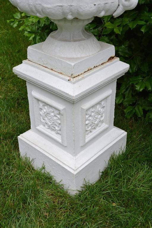 20th Century A Pair of White Painted Cast-Iron Urns on Pedestals For Sale