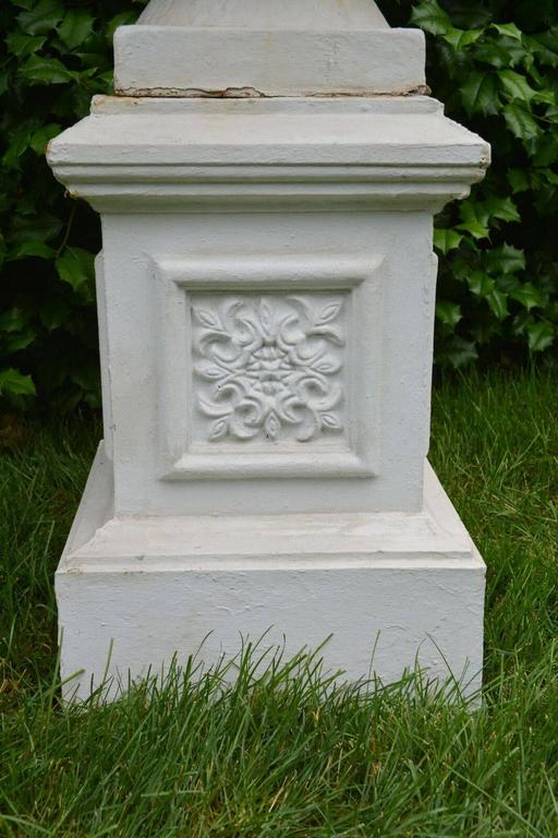 A Pair of White Painted Cast-Iron Urns on Pedestals For Sale 4