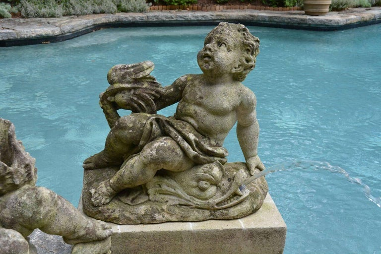 Stone Pair of Carved Cherub Fountains For Sale