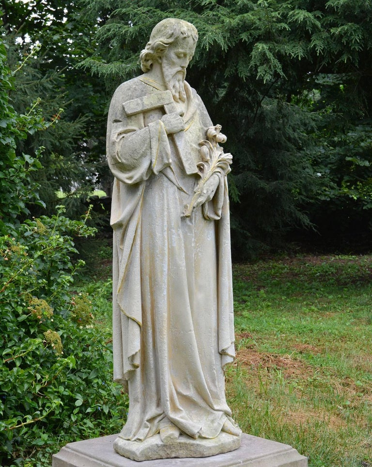 A carved limestone statue of St. Joseph, the patron saint of carpenters, fathers, and the afflicted, shown with his attributes of a lily and a carpenter's square, traces of gilt-edging overall, English, circa 1890. Measures: 61.5 ins. high, 20 ins.