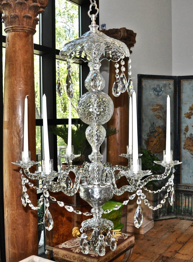 Irish cut-crystal chandelier of the Waterford area in Georgian style  - Early to mid-19th century - Silvered brass fittings - Exquisite cut and design - In very good condition - Now with candles but can be French wired at customer's