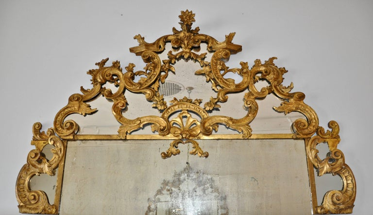 Rococo Pair of 18th Century Carved Gilt Wood Overdoor Mirrors For Sale