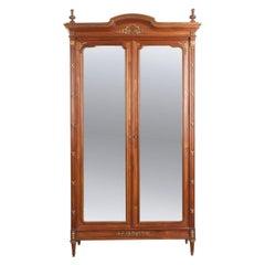 French 19th Century Louis XVI Style Mirrored Walnut Armoire