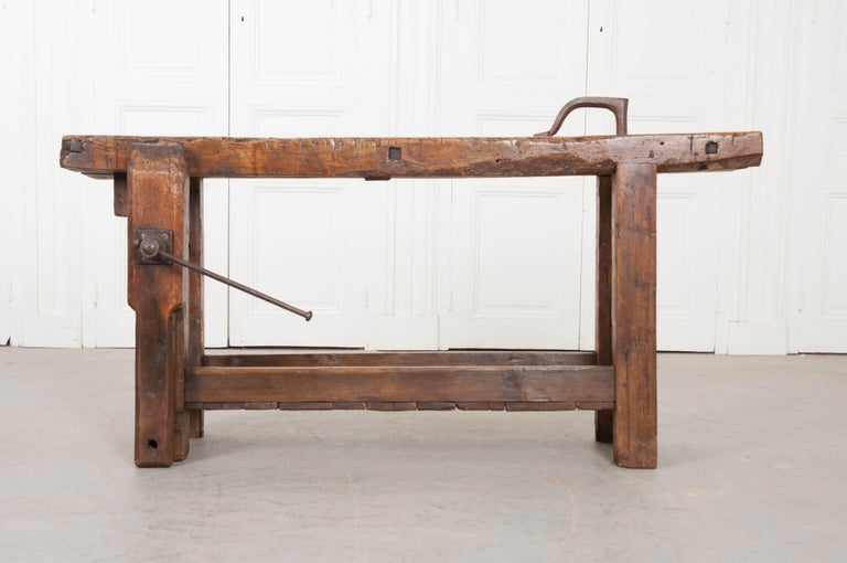 Many projects have been completed over the years using this 19th century French workbench. Deep marks are scored into every inch of the work surface, left there by the saws and chisels of history's craftsmen. The workbench has hand-forged iron