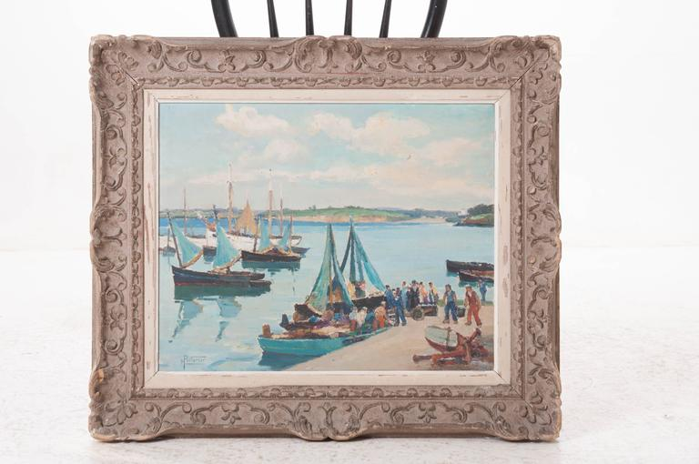 Born January 22, 1875, Maurice Pellerier painted this delightful landscape depicting fishermen in Brittany returning with the day's catch. A heavily carved frame surrounds the piece in a cool, antique gray, circa 1937.
