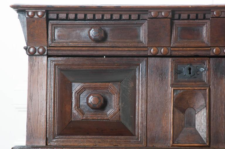 An extraordinary oak chest of drawers from the mid-17th century, England. Remarkable craftsmanship was employed when making this amazing piece. Wonderfully carved details can be found all-over this antique chest. Above the top two drawers are carved
