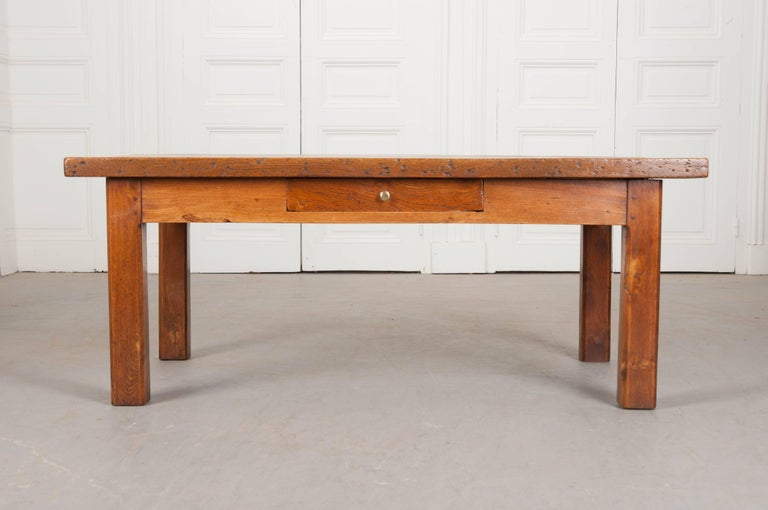 A French provincial chestnut coffee table from 19th century France. Two thick, solid chestnut boards comprise the top of this exceptional low table. These boards contain marvelous burl and grains that can be found throughout the tabletop. The