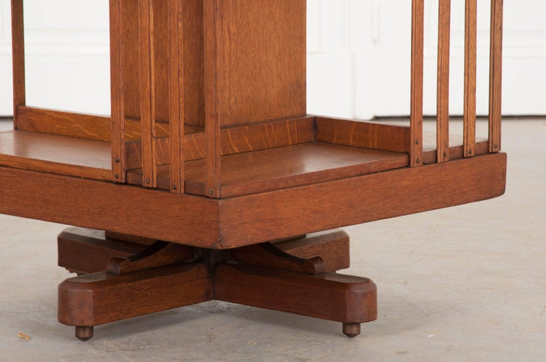 Patinated English 19th Century Oak Revolving Bookcase by S & H Jewell For Sale