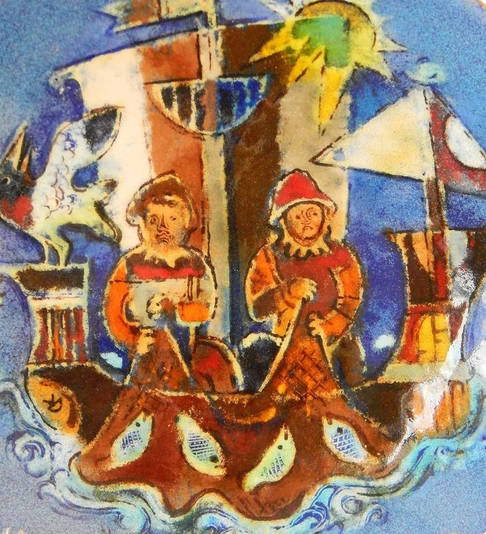 Featuring the deep blue, red and green jewel-tones for which he was famous, this rare and important footed enamel dish was created by the great master of enamel painting, Karl Drerup. Here, Drerup depicts two fishermen on an exotic vessel, pulling