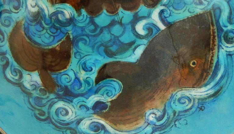 The finest and most dramatic piece of enamel painting we have seen by master artist Karl Drerup, this large bowl depicts a spouting whale amidst a gorgeous sea of waves in shades of cobalt, cerulean, Mediterranean blue and pale blue, framed by a