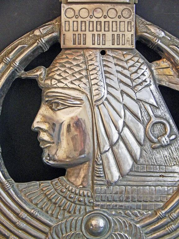 Fabulous, stunning and probably unique, this nickeled bronze bas relief sculpture was created for the Land Bank of Egypt's office in Paris in the late 1920s, capturing the logo of the bank in three dimensions. At the center of the cartouche is a